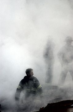 WTC 9/11 share and attribute user slagheap, via Flickr. New York, N.Y. (Sept. 14, 2001) -- A fire fighter emerges from the smoke and debris of the World Trade Center. The twin towers of the center were destroyed in a Sep. 11 terrorist attack. Released U.S. Navy Photo by Photographer's Mate 2nd Class Jim Watson.