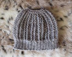 Messy Bun Beanie in Gray with cool texture. On Etsy by Hott Knots Made in Italy. This is a dressed up version, not so messy!