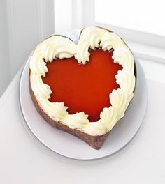 Valentine's Day Flowers & Gifts - Eli's Heart-Shaped Cheesecake - FedEx - The Eli's Heart-Shaped Cheesecake is a sweet way to win their heart and offer your love! Scrumptious creamy white chocolate cheesecake is topped with a red raspberry mirror and a border of whipped cream on a dark chocolate crust in a decorative heart-shaped container to create an indulgent gift they won't be able to resist. 7 Heart-shaped cheesecake ships frozen. Certified Kosher dairy.
