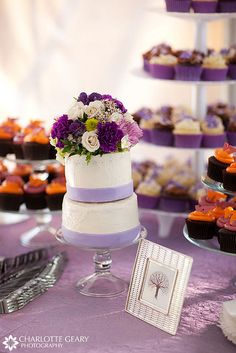 (Wedding colors: Purple and Orange) Lavender wedding cakes and groom's cupcakes by Charlotte Geary Photography, via Flickr
