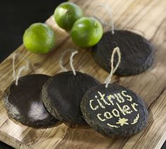 Paint sliced tree branch rounds with chalkboard paint for Beverage Dispenser Tags... @Candice Blythe wedding idea?