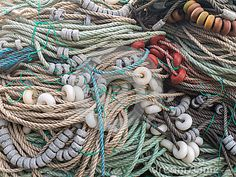 LUARCA, SPAIN - DECEMBER 4, 2016: Colorful ropes,floats and sinkers at the fish market pier in Luarca, Spain.