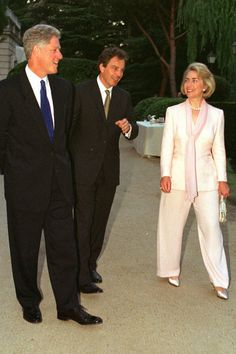 She was glowing in ivory, alongside husband Bill Clinton and Tony Blair. Chelsea Clinton Wedding, Hillary Rodham Clinton, Tony Blair, Power Dressing, American Presidents, The Hollywood Reporter, Family Events, World Leaders, Skirt Suit