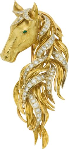 Diamond, Emerald, Gold Clip-Brooch, Neiman Marcus -  The brooch, designed as a horse head, features full and single-cut diamonds weighing a total of approximately 1.65 carats adorning the mane, enhanced by a round-cut emerald eye, set in 18k yellow gold, completed by a double pinstem and catch mechanism on the reverse.