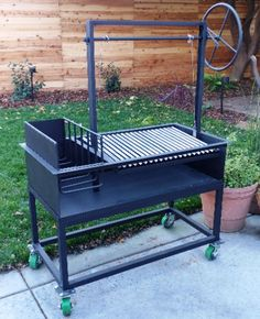 Kayak Storage Pallets The Ash is an Argentine Grill with Side Brasero and Wheel plus cart - The Ash is an Argentine Grill for Wood or Charcoal Grilling with Side Brasero X X includes adjustable grill grate, slanted V-Grate, wheel and cart. Diy Grill, Barbecue Grill, Santa Maria Grill, Asado Grill, Parrilla Exterior, Argentine Grill, Grilling Sides, Grill Grates, Wood Grill