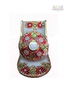 A perfect gift for any occasion.it can be used as holding mobile visiting cards stationery item etc. Made of White Marble with beautiful Painting Work having a watch in middle.