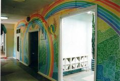 Vibrant rainbow mural painted in a hallway of a building. Murals, Commercial, Vibrant, Rainbow, Hand Painted, Building, Furniture, Home Decor, Rain Bow