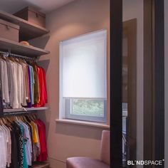 Hidden electric blinds for privacy in inward facing closet window.