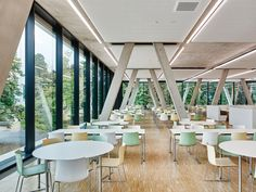 "The Karlsruhe Institute of Technology (KIT) is a renowned University of Technology and German research centre. The idea for the new canteen was that staff, students and guests should have the feeling they were sitting in a space surrounded by trees. The ""casino"" was therefore designed as a highly transparent structure with canted exposed concrete columns, and integrated perfectly into the wooded landscape – like a garden pavilion."