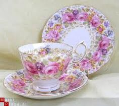 pretty pink rose wreath with purple accents on a white background cup and saucer