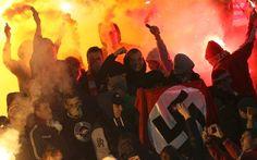 Russian hooligans brandishing a Nazi flag during a match between Shinnik Yaroslavl and Spartak Moscow Когда…