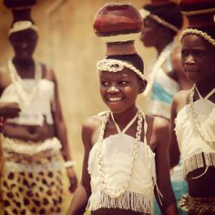 Acholi cultural dancers perform the pot dance to celebrate the current prosperity in the North.