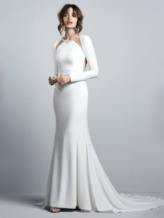 Sottero and Midgley - ARLEIGH, This Talin Stretch Crepe sheath wedding dress evokes Old Hollywood glamour, featuring long sleeves and an illusion open back accented in beading and Swarovski crystals. Illusion cutouts at the embellished jewel neckline complete this sexy yet elegant gown. Finished with crystal buttons trailing down the train over zipper closure.