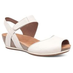 Beautiful soft milled nubuck combines with a fully adjustable ankle strap and a sleek looking wedge. HappyFeet.com has your healthy footwear since 1985.
