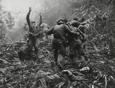 Amateur photographer Art Greenspon shot this photo in April 1968, in the A Shau Valley of Vietnam. The soldier with raised arms is guiding a medical helicopter for landing: