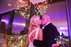 Sarah + Ryan = Married!  Baby, you're a firework!  Fireworks with the city skyline at D'Amore makes for fabulosity in this gorgeous dress - love the back.  #Indy #Wedding #Fireworks #DAmore