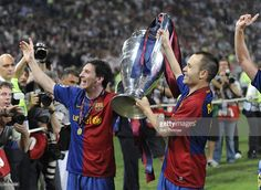 Lionel Messi and Andres Iniesta (right) of Barcelona celebrate with the trophy after the UEFA Champions League Final match between Barcelona and Manchester United at the Stadio Olimpico on May 27, 2009 in Rome, Italy. Barcelona won the match 2-0.
