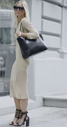 Blogger Celine Aagaard from Envelope.no in By Malene Birger Millos dress, Subki shoes and carrying the Grinolas bag