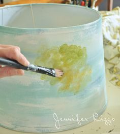 Pounce paint onto the surface of the lamp shade in a radnsom pattern for a water color look