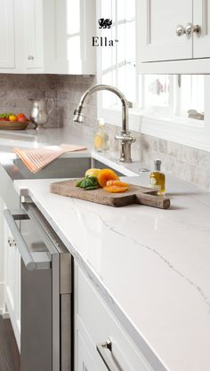 The look of marble countertops with none of the maintenance, Cambria quartz countertops are easy to clean and more durable than marble. Cambria Ella mimics the look of marble, a white countertop with dove-gray undertones and gray veins running laterally. Cambria Quartz Countertops, Granite Countertops Colors, Outdoor Kitchen Countertops, Kitchen Countertop Materials, Granite Kitchen, White Kitchen Cabinets, New Kitchen, Kitchen Decor, Kitchen Island