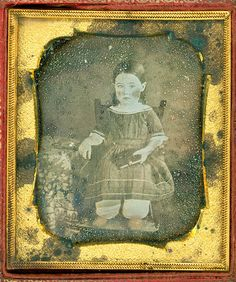 Dag_00040 :: girl holding an album by cosmorochester collects, via Flickr