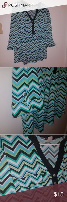 """Cocomo Woman 2x Chevron Blouse 3/4 cuffed sleeve, multicolored Chevron blouse.  2 functional pockets with pleating sewn under pocket.  Black trim V neck with 4 buttons.  96% polyester 4%  spandex.  Teal, turquoise, white, lime and black chevrons.  In great uses condition.  Shows no wear, has no tears or holes.  27"""" shoulder to hem,  23"""" AP to AP. Cocomo Woman Tops Blouses"""
