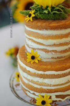 Jody and Garret's Camp Lakodia Naked Wedding Cake with fresh Sunflowers.