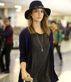 Travel fashion: Jessica Alba arrived at Los Angeles International Airport on Monday in a simple outfit she made unique with a floppy fedora