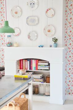 Floral wallpaper and fireplace converted to book shelf!