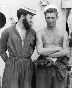 sailors [ luv the look of the left side (and his beard ) to his companion ]