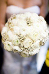 I'm in LOVE! Looks like Ranunculus and baby's breath!!