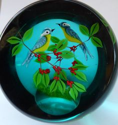 This is one of a small number of beautiful Scottish Caithness paperweights designed by glass maestro, William Manson - which are available my Etsy store.  This lovely is called Blue Tits - and is number 22 of a very small limited edition of only 50 weights. There is a tiny WM cane underneath the leaves at the back of the weight. It is fully inscribed with edition details, title etc on the base. It was issued in 1993 - and the original issue price for this beautiful weight was £199.  So my…
