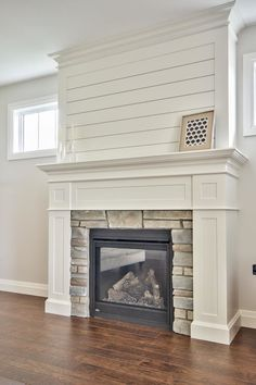 Clean White Custom milled fireplace surround with shiplap and stone accents. #BickellBuilt