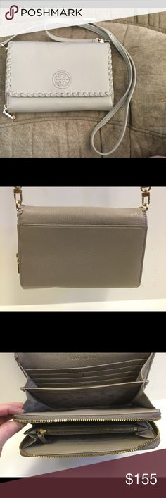 "Re-Posh 🌟Tory Burch Marion Wallet Cross Body! 🌟 This Tory Burch Marion Flat Wallet Cross Body is in excellent used condition!  It's made of a soft French Grey pebble leather and has a ton of organization.  Sixteen card slots, 2 zippered compartments and more!  It measures 8""w x 5.5""h x 1.5""d.  The strap is adjustable with 21"" being the shortest strap drop.  Lovely!  No trades please! Tory Burch Bags Crossbody Bags"