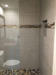 Beautiful bathroom shower remodel     #bathroom #tile #granite #glass #shower #gannoncustomhomes #localbusiness #texas #remodel #custombuilder #interior #design #professional #contractor #construction #residential #business #family