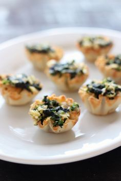 Easy appetizer. Spanakopita Bites:  spinach and cheese stuffed phyllo.  Make ahead and freeze then pop in the oven for 10 minutes!