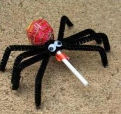 Sweet Treat: Spider pops! Although I'm thinking of making these with cake pops instead...