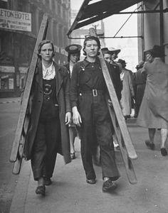 U.K. Female window washers walking to their next job. - September 1941 London. Notice how everyone is female.