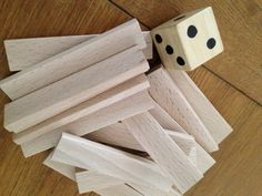 voor slimmere kleuters: kapla telspel Spelen met een dobbelsteen met cijfersymbolen.