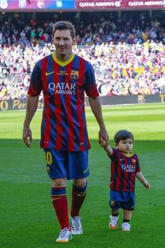 Lionel Messi and his adorable son Thiago Messi hand and hand during a FC Barcelona game.