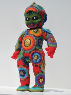 """Beading by Jan Huling – Big Red Kewpie  """" I find forms that appeal to me, sometimes Frankensteining forms together, and then I cover them in beads, chain, buttons, tokens, but mostly 11/0 glass seed beads, mostly from the Czech Republic."""""""
