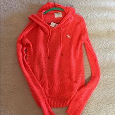 SALE!Abercrombie & Fitch Spring Sweater/Hoodie Abercrombie & Fitch Orange Sweater/Hoodie. Beautiful exclusive A & F Sweater. Never worn. Abercrombie & Fitch Tops Sweatshirts & Hoodies