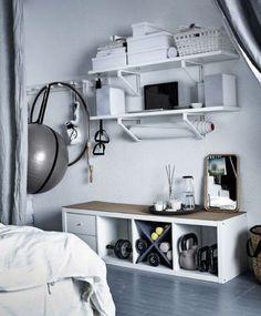 Idea for workout gear above corner bookcase -- 75 Cool IKEA Kallax Shelf Hacks | ComfyDwelling.com
