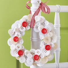 We love making this adorable holiday decoration with the kids -- its simple design is easy enough to do together! Let the kids decide which buttons to use, and help hot-glue each button to a cardboard base until the wreath looks full. Hang with holiday ribbon.