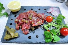 Tuna tartare with chopped gherkins, red onion and a splash of soya sauce.