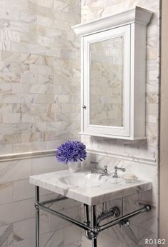 AKDO Product(s) Shown: Calacatta (H) 3 x 6 Tile, Calacatta (H) 12 x 12 Tile, Calacatta (H) Classic Rail Molding, Install courtesy of: CTW Designs Marble Subway Tiles, Marble Mosaic, Mosaic Tiles, Wall Tiles, Imperial Tile, Calacatta Tile, Calcutta Gold Marble, Marble Room, Transitional Bathroom