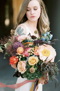 This colorful wedding bouquet by Jules with the Flowers was featured in a real wedding on The Knot. Like what you see? Check out more from the chic elopement and view the full wedding album. Personalize your wedding and put a spin on tradition with The Knot's customizable wedding websites, wedding invitations, registry (and more!). Not sure where to start? Get ideas and advice from our editors on everything from wedding colors and venue types to all things guest.