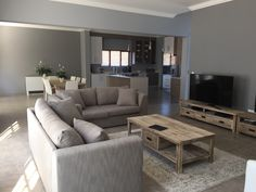 Open plan living area, natural warm tones. My house