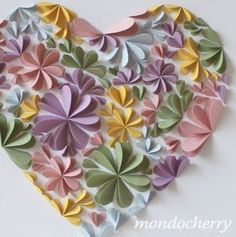hearts folded in half to make flowers, glued in heart shape