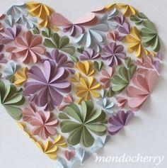 hearts folded in half to make flowers, glued in heart shape